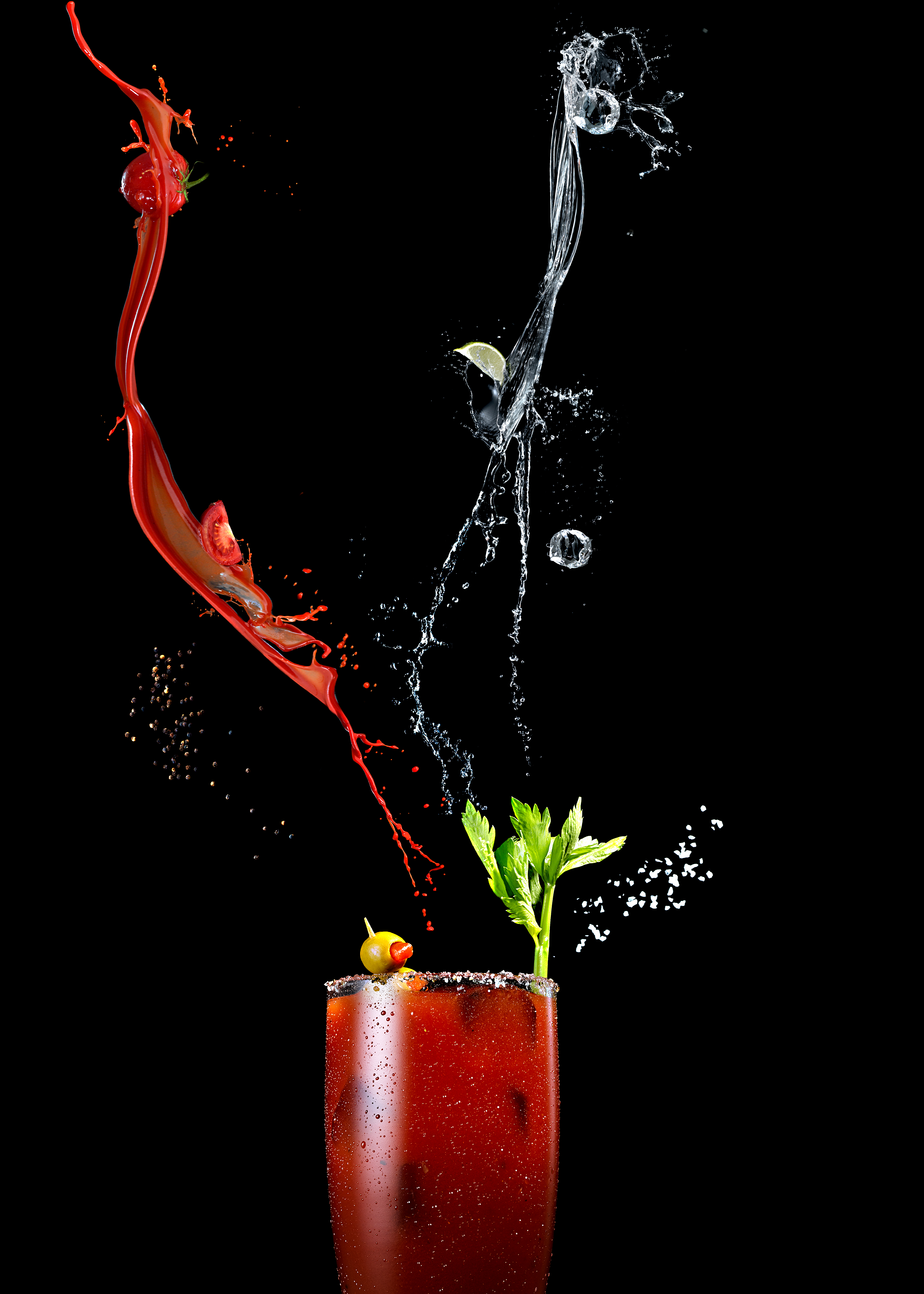 Vijey Mohan | Product & Liquid Photographer based in Los Angeles, California.   This shot was done by Vijey Mohan with splashes of vodka, Tomato juice to showcase the beauty of a bloody mary cocktail with the ingredients.